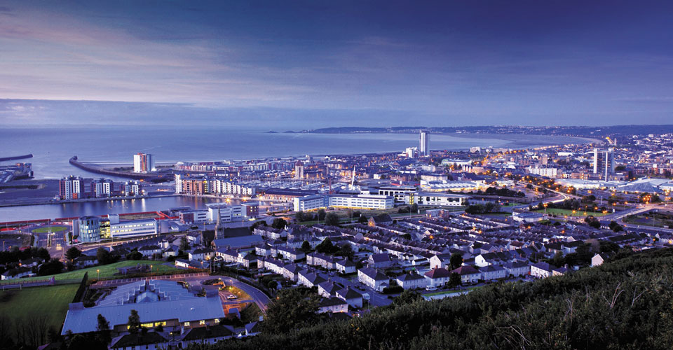 swansea city skyline showing properties in mumbles, marina and sanfields